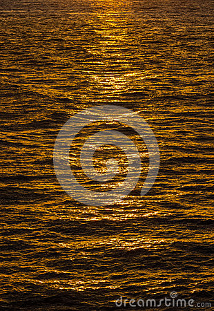 Pattern of ripples in the ocean reflecting sun