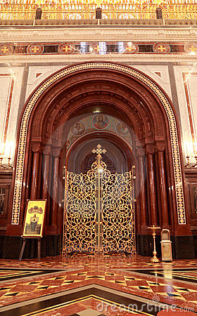 Patterned gilt door in arch inside Cathedral