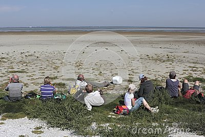 Pause during a tour of monuments  on the Wadden island Griend Editorial Image