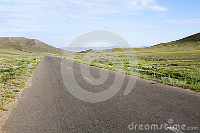 Paved Road through Mongolian Steppes