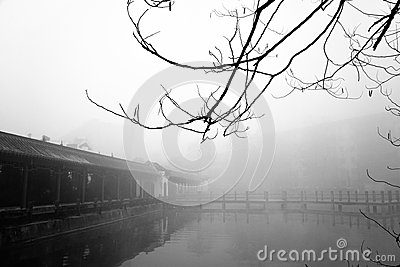 Ancient pavilion in the fog