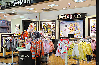 Paw in paw  baby clothes shop Editorial Image