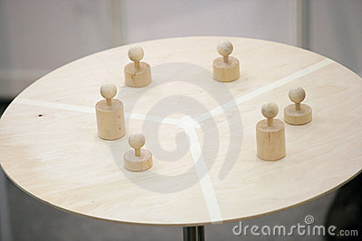 Pawns on round table