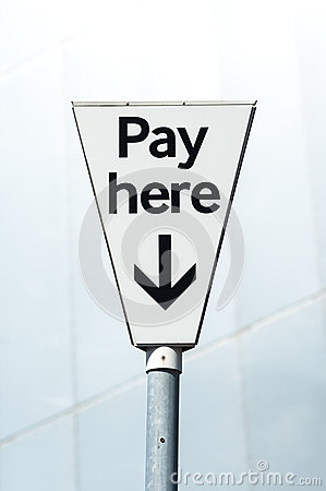 Pay Here sign. Pay and display carpark