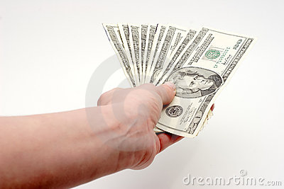 Paying bills with cash Stock Photo