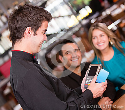 Paying by credit card at the restaurant
