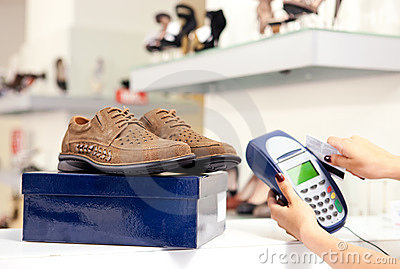 Paying using credit card terminal in shoe store