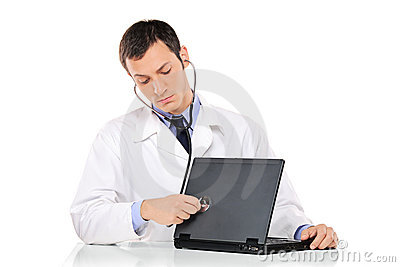 PC doctor examining a laptop computer