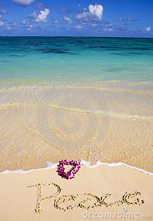 Peace written in the sand on a beach