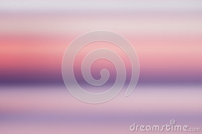 Peaceful concept Abstract blur beautiful purple ocean with pink sky sunset background. Stock Photo