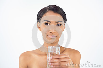 Peaceful attractive model holding glass of water