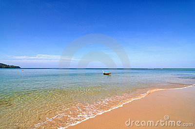 Peaceful beach with boat
