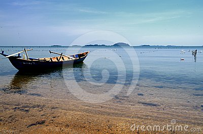 Peaceful boat on the beach of Rabbit Island