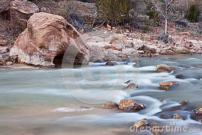 Peaceful river with red sandstone rocks