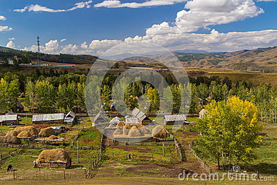 Peaceful Rural Village against Autumn Forest Stock Photo
