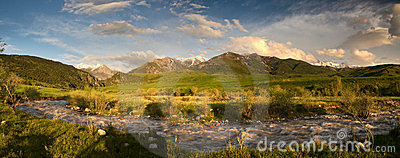 Peaceful view of mountain range in sunlight