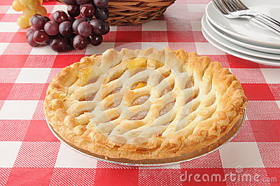 Peach pie on a picnic table