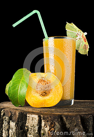 Peaches and glass with juice