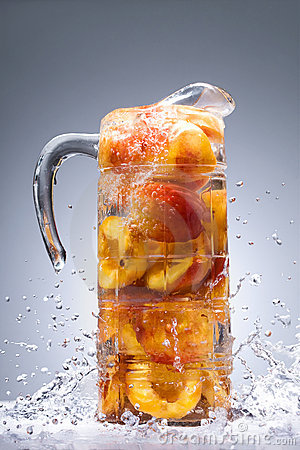 Peaches with juice in a jug