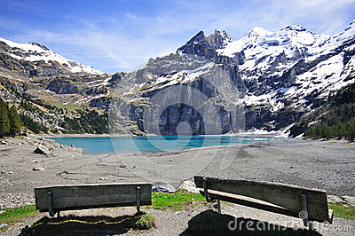 Peaks and lake in Alps