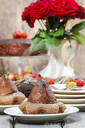 Pear in cake with chocolate sauce
