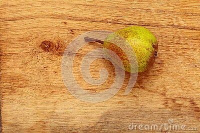 Pear fruit on wooden table background