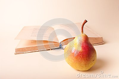 Pear and old book