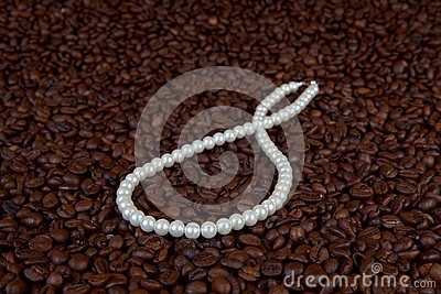 Pearl beads in coffee beans