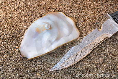 Pearl oyster and knife