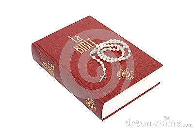 Pearl rosary and Holy Bible on white background