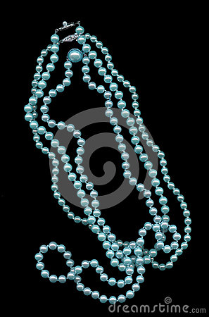 Beautiful blue pearls on black background