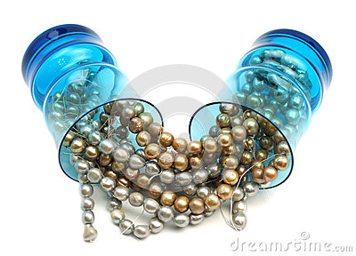 Pearls in blue drinking glasses