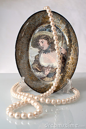 The pearls and a decorative plate