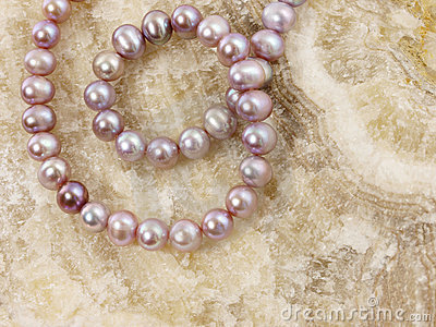 Pearls necklace on a stone