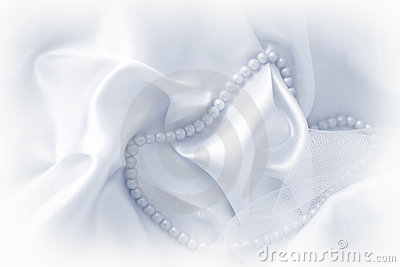Pearls on silk fabric