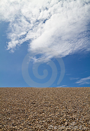 Pebble beach  against a blue sky
