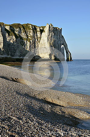 Pebble beach and cliff of Etretat in France