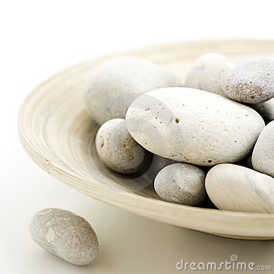 Pebbles in bamboo bowl