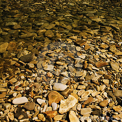 Pebbles under water.