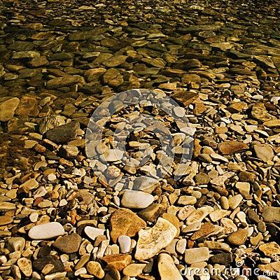 Pebbles under water.