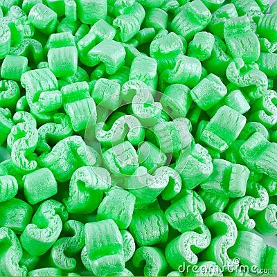 Pedazos verdes de la espuma de poliestireno