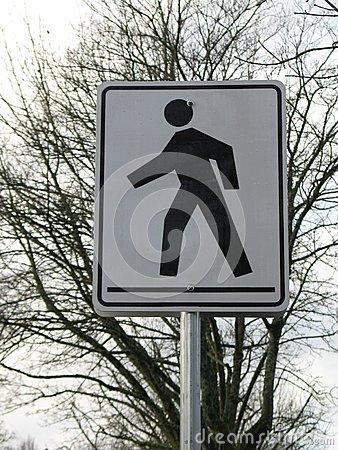 Black and white pedestrian crossing sign. Keywords: