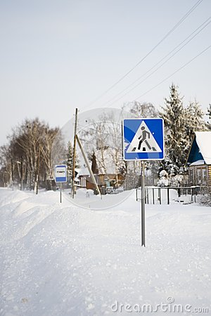 Pedestrian crossing traffic sign on winter road