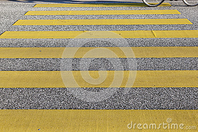 Pedestrian crossing with yellow stripes