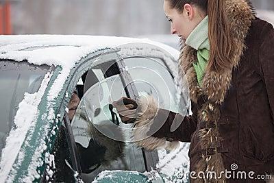 Pedestrian talking with car driver