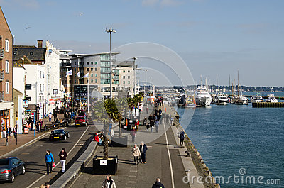 Pedestrians on Quayside, Poole Harbour Editorial Stock Image