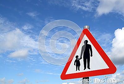 Pedestrians in road sign.