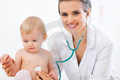Pediatric doctor examine kid using stethoscope