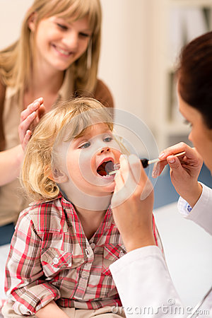 Pediatrician examine child throat look with light