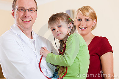 Pediatrician with family in his surgery